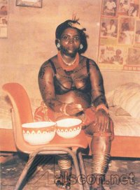 Mboppo girl in seclusion. Note the body painting designs. (Courtesy: Theresa I. Iwok)