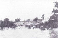 A view from the river at the beginning of the century. Left is the sand ramp and mono-rai line, brought from Asaba and used in reclaiming the swampy ground. (Source: NAI)
