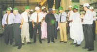 At a shareholder's inspection tour of the plant in November 1996: (left) Randy Reynolds, Roy Lee, Dr. H. Beister, Werner Holtey, Eng. M. Mohammed, Alh. B. Dalhatu, ALSCON Chairman, Dr. Klaus von Menges, Ingo Cammans, Alh. Aminu Kani, and Arnulf Ldkenhoff